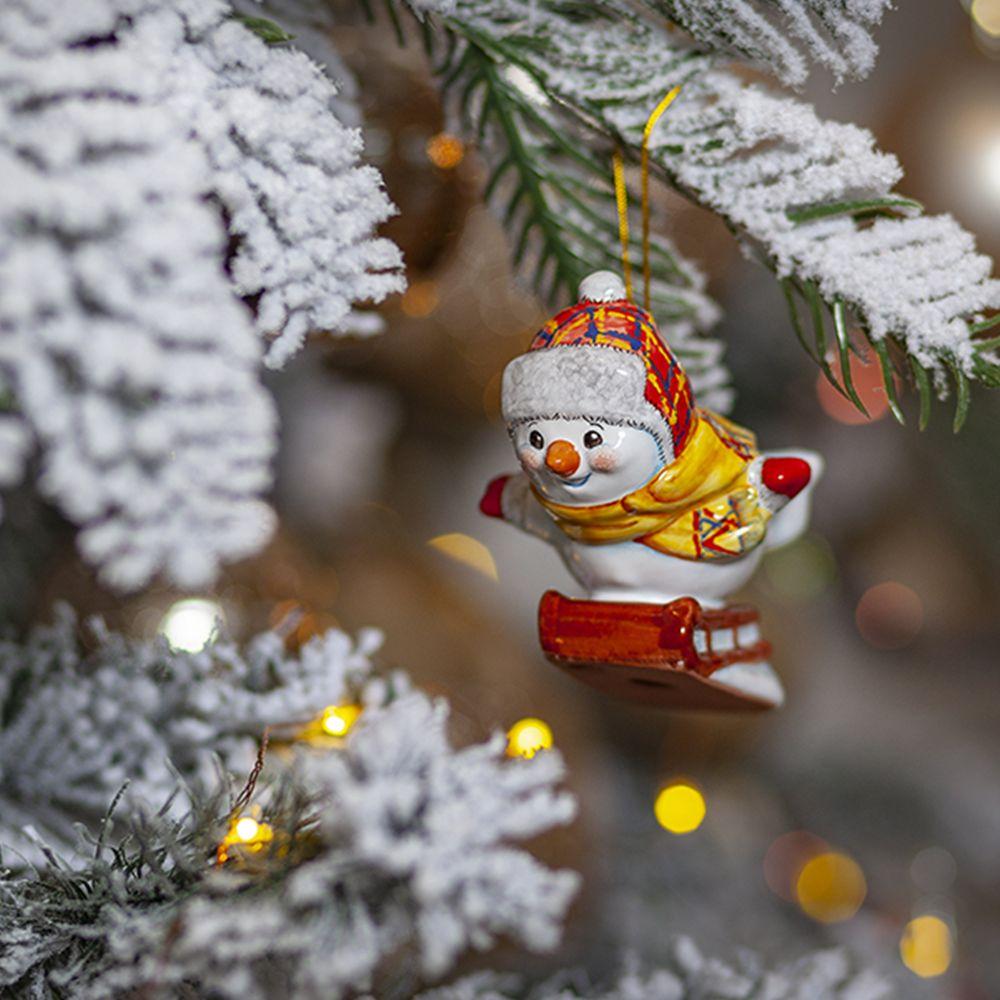 Снеговик на санках фото